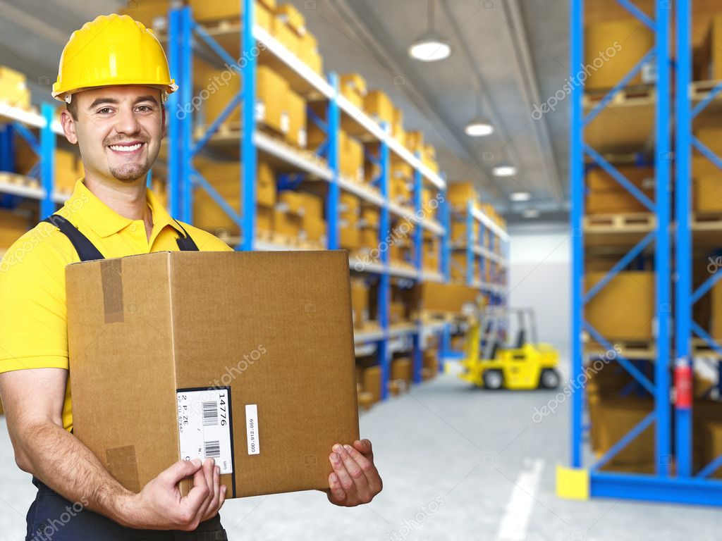 Manual worker with parcel and warehouse parcel — Stock Photo #3628224