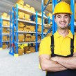 Smiling manual worker - Stock Photo