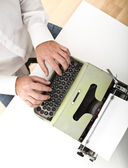 Man with vintage typewriter — Stock Photo