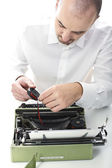 Man fix vintage typewriter — Stock Photo