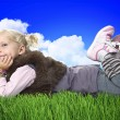 Little girl layd on grass — Stock Photo
