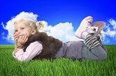 Little girl layd on grass — Photo