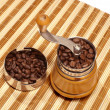 Manual coffee grinder on a bamboo napkin — Stockfoto