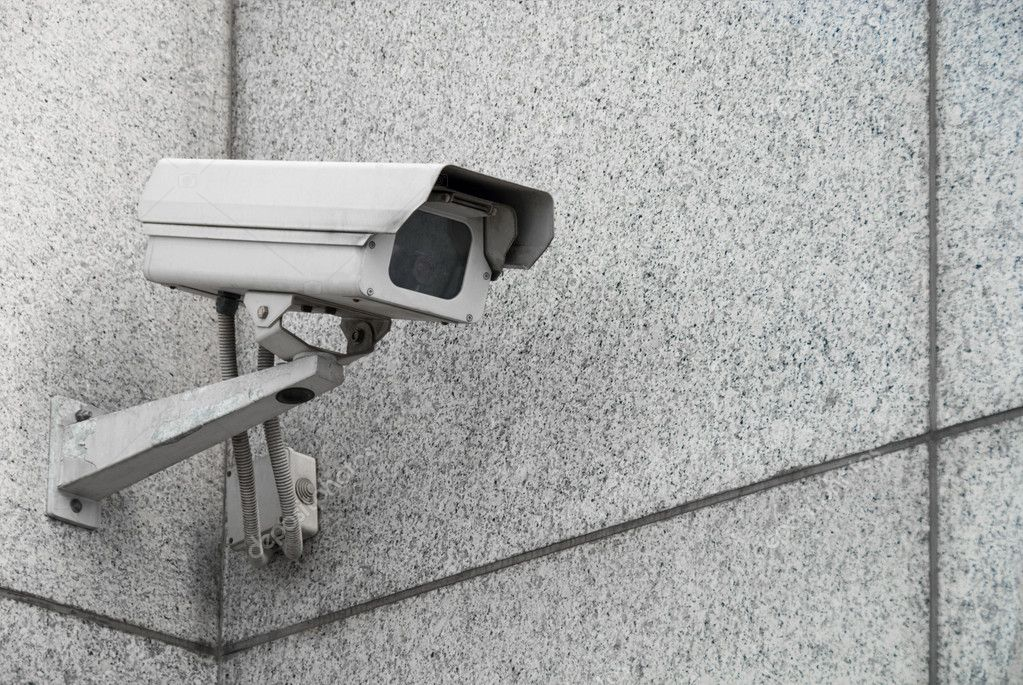 Outdoor surveillance camera on the facade of the building — Stock Photo #2806920