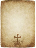 Cross on old parchment — Stock Vector