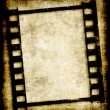 Grungy film strip or photo negative - Stock Vector