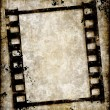 Grungy film strip or photo negative — Stock Vector