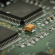 Chips on circuit board - Stock Photo