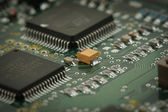Chips on circuit board — Stock Photo