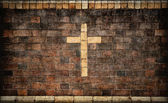 Christian cross in brick wall — Stock Photo