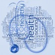 Foto Stock: Stethoscope and health wordcloud