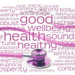 Royalty-Free Stock Photo: Pink stethoscope and health wordcloud