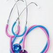 Pink and blue stethoscopes — Stock Photo