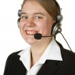 Young business woman with headset isolated on white — Stock Photo