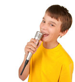Boy singing into microphone isolated — Stock Photo