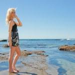 Young woman enjoying summer at beach — Stock Photo