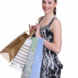 Young woman with shopping — Stock Photo