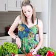Young woman preparing healthy vegetables — Stock Photo #3846597