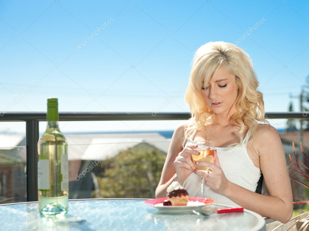 Young woman has wine and dessert in cafe — Stock Photo #3860736