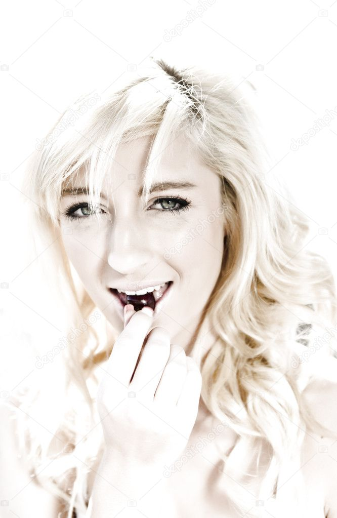 High key image of a young woman eating a cherry — Stock Photo #3860744