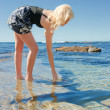 Young woman on reef at sea — Stock Photo