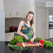 Young woman preparing healthy vegetables — Stock Photo #3877497