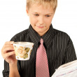 Young successful businessman relaxing and drinking coffee — Stock Photo