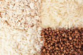 Rolled oats, rice and buckwheat — Stock Photo