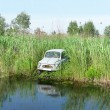 Old car on the river - Foto de Stock