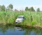 Old car on the river — Stock Photo