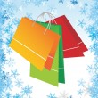Shopping bags on christmas background - Grafika wektorowa