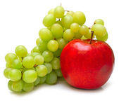 Red apple and green grapes — Stock Photo