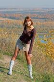 Girl against autumn nature — Stock Photo