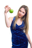 Girl in blue dress with a green apple — Stock Photo