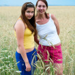 Girls in rye field — Stock Photo