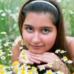 Girl on chamomiles field — Stock Photo