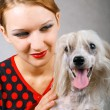 Beautiful girl and chinese crested dog — Stock Photo #3768565