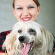 Girl and chinese crested dog on grey — Stock Photo #3778518