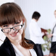 The young business woman at office — Stock Photo