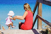 Little happy girl and her mother — Stock Photo