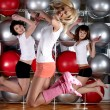 Young charming girls go in for sports — Stock Photo
