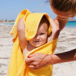 Charming little girl in a yellow towel — Lizenzfreies Foto