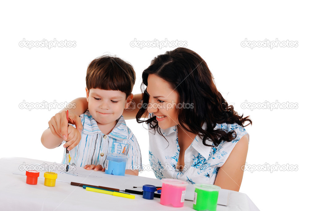 Young mother and her little son paint colors in this album — Stock Photo #3125147
