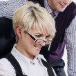 The charming young business woman in office — 图库照片