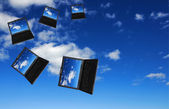 Flying flock of laptops — Stock Photo
