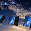 Flying flock of laptops — Stock Photo #3332969