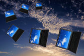 Flying flock of laptops — Stockfoto