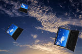 Flying flock of laptops — Stok fotoğraf