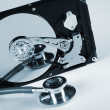 Stock Photo: Computer hard drive and a stethoscope.