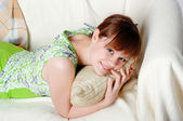Young lovely brunette in green pajamas — Stock Photo
